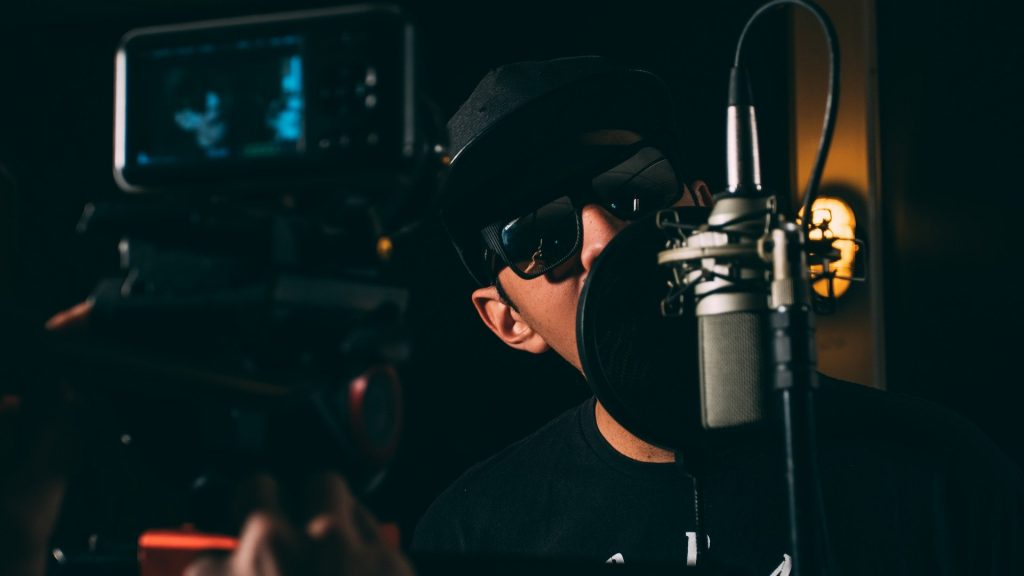 image of a rapper recording a song